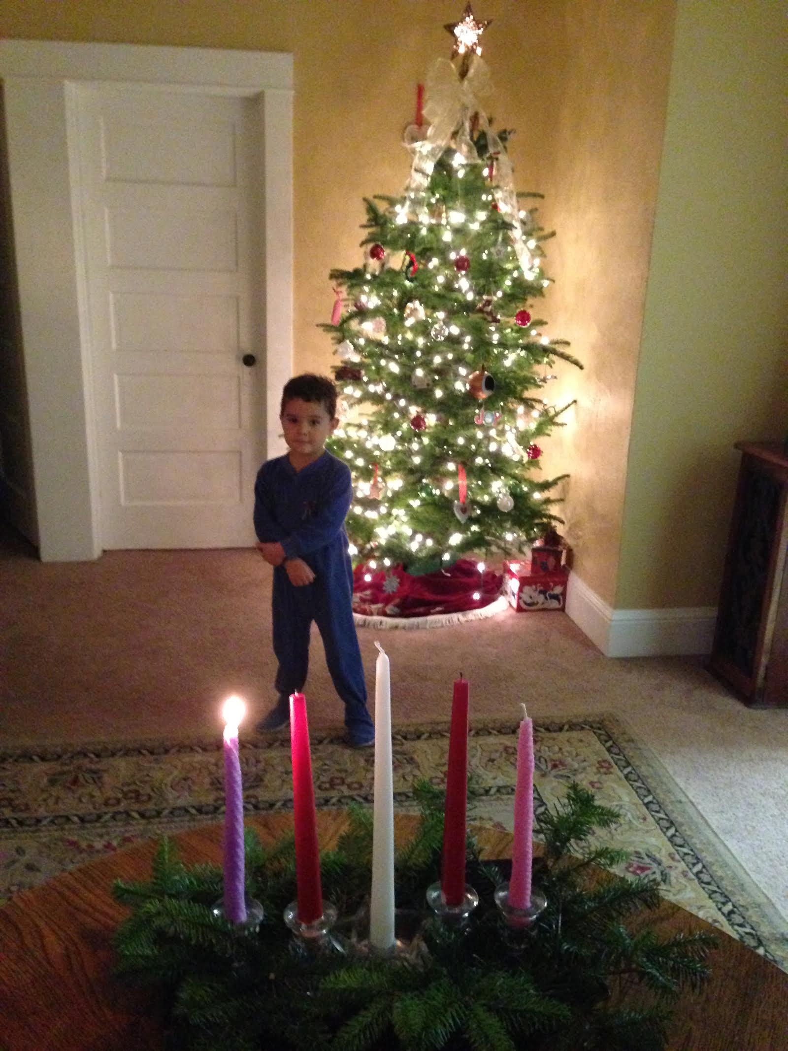 isaac admiring candle