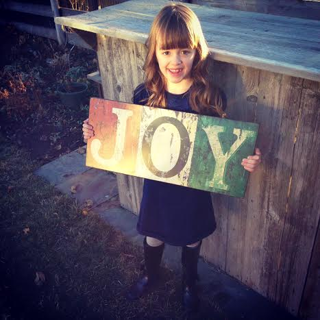 jenna holding joy sign